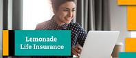Woman smiling lookin up lemonade life insurance on her laptop