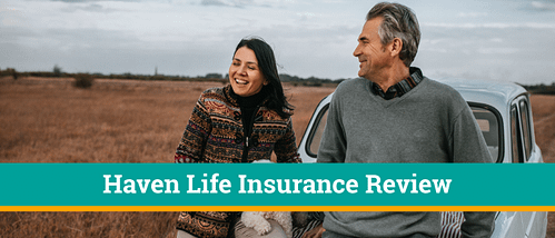 Man and woman are walking on beach smiling after a review of Haven life insurance